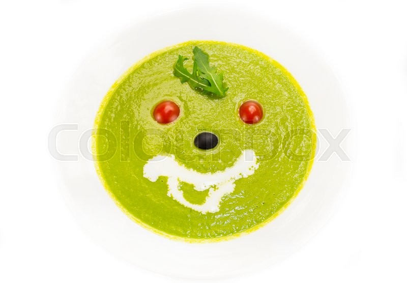 Stock image of 'Pea soup  a white dish at restaurant'