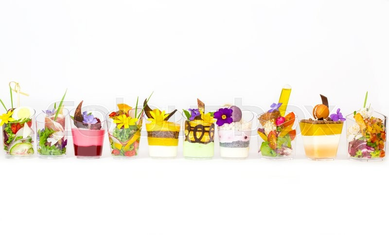 Stock image of 'Mini canapes in plastic cups decorated with edible flowers'