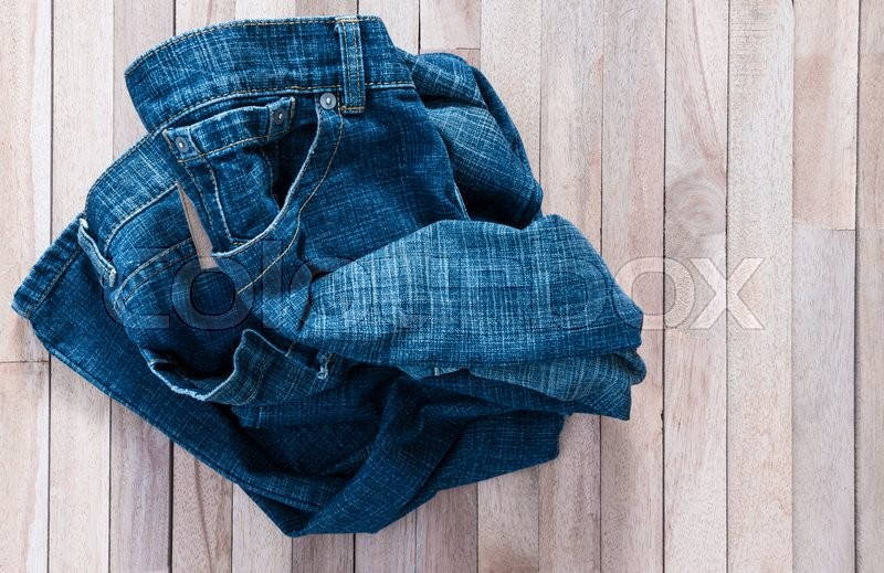 Stock image of 'Vintage Jean on a wooden background'
