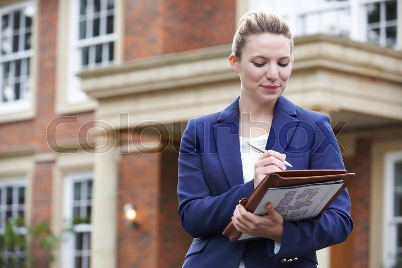 Stock image of 'Female Realtor Standing Outside Residential Property'
