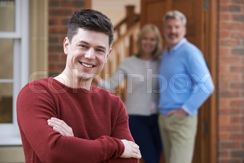 Stock image of 'Portrait Of Young Man With Parents At Home'