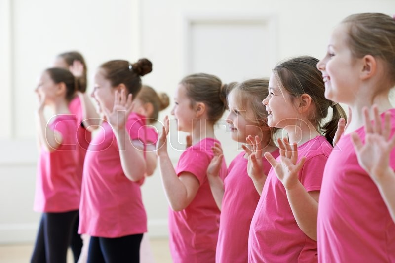 Stock image of 'Group Of Children Enjoying Drama Class Together'