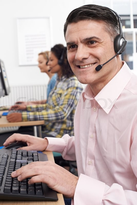 Stock image of 'Male Customer Services Agent In Call Centre'