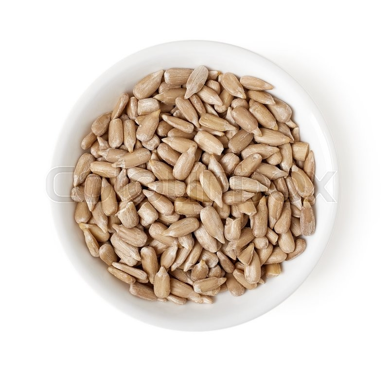 Stock image of 'Bowl of sunflower seeds isolated on white background, top view'