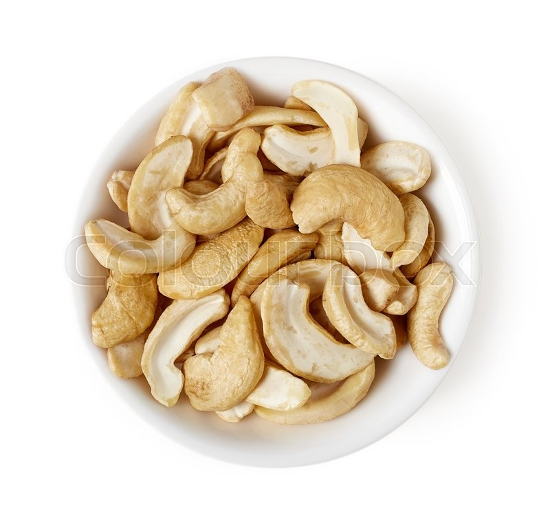 Stock image of 'Bowl of unshelled cashew nuts isolated on white background, top view'