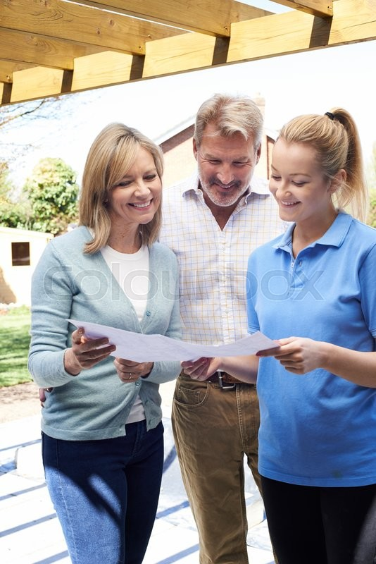 Stock image of 'Mature Couple Discussing Plan With Landscape Gardener'