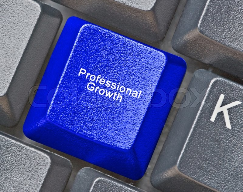 Stock image of 'Keyboard with key for professional growth'