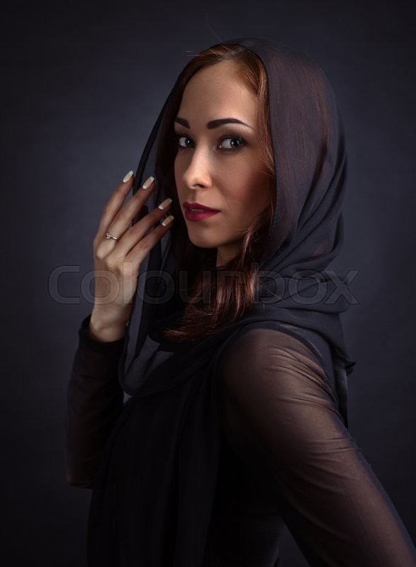 Stock image of 'Portrait of young beautiful woman in black dress'