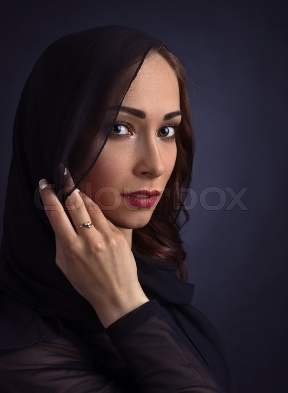 Stock image of 'Portrait of young beautiful woman in black'