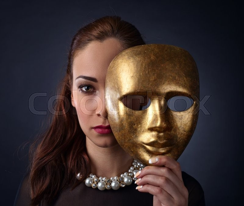 Stock image of 'Beautiful woman in black dress with gold mask'