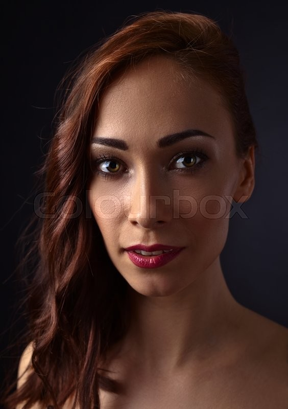 Stock image of 'Portrait of young beautiful woman with log hair'