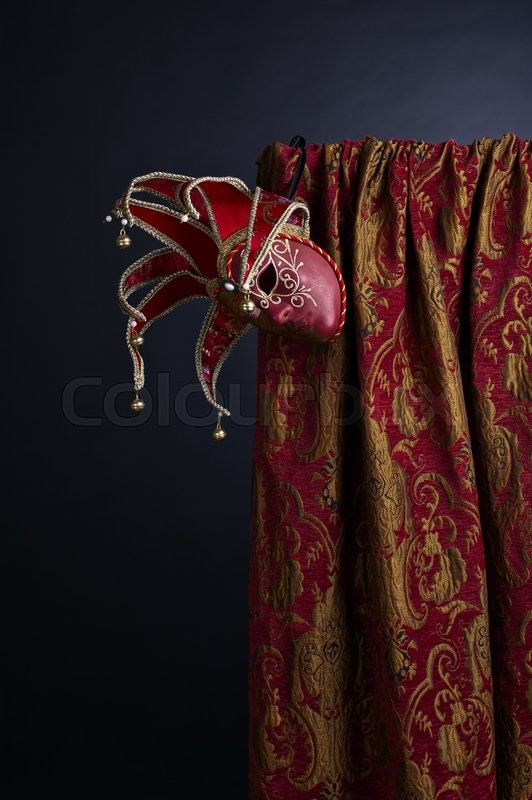Stock image of ' Old Venetian masks with bell on dark background'