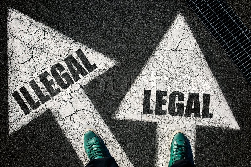 Stock image of 'Dilemma concept with mans legs on leggal and illegal signs on the road '