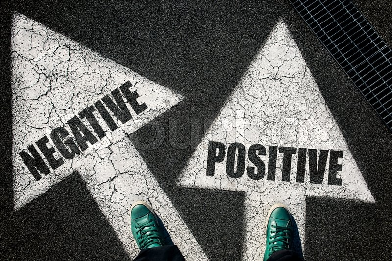 Stock image of 'Dilemma concept with mans legs on positive and negative signs on the road '