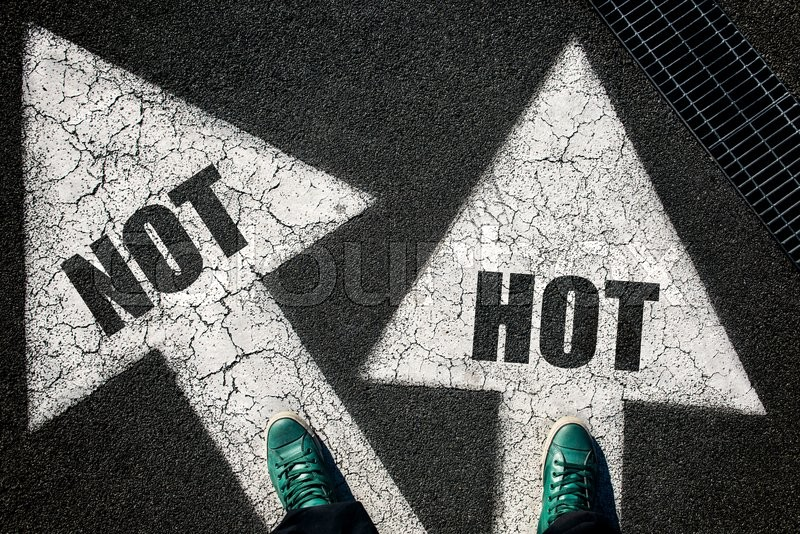 Stock image of 'Dilemma concept with mans legs on not and hot on the road '