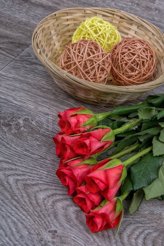 Stock image of 'Red roses on a grey wooden background'