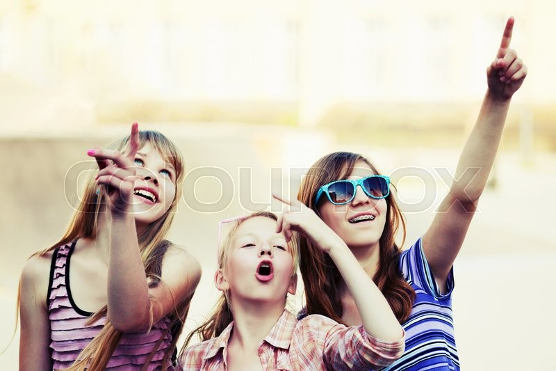 Stock image of 'Group of teenage girls having a fun outdoor'