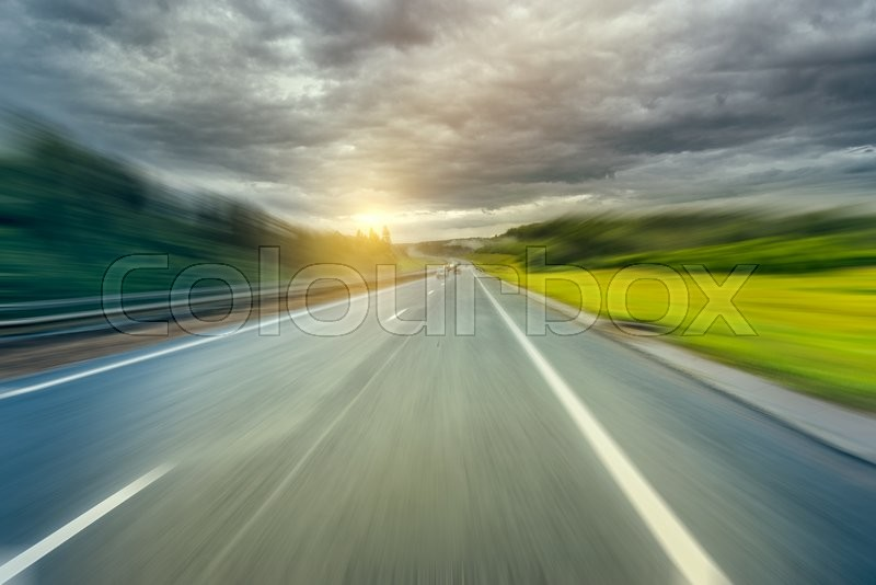 Stock image of 'Early morning view of the new highway under the stormy skies.'