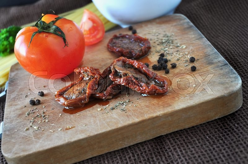 Stock image of 'Close up dried tomato and spice on wooden board'