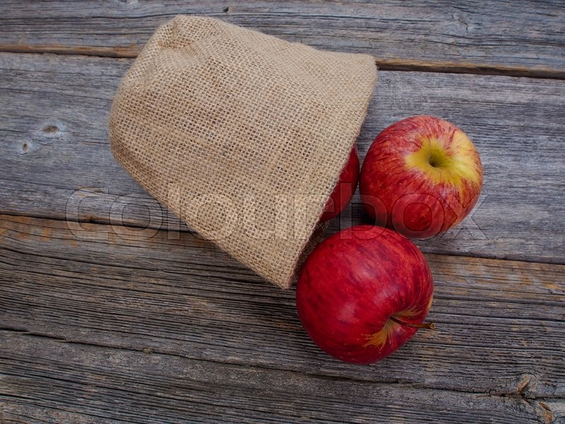 Stock image of 'Apples on an old table'