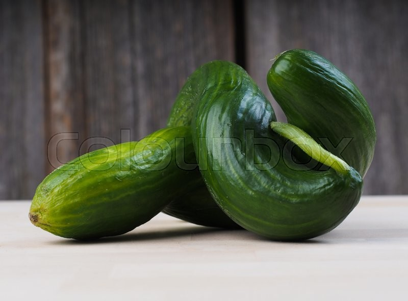 Stock image of 'Twisted cucumbers'