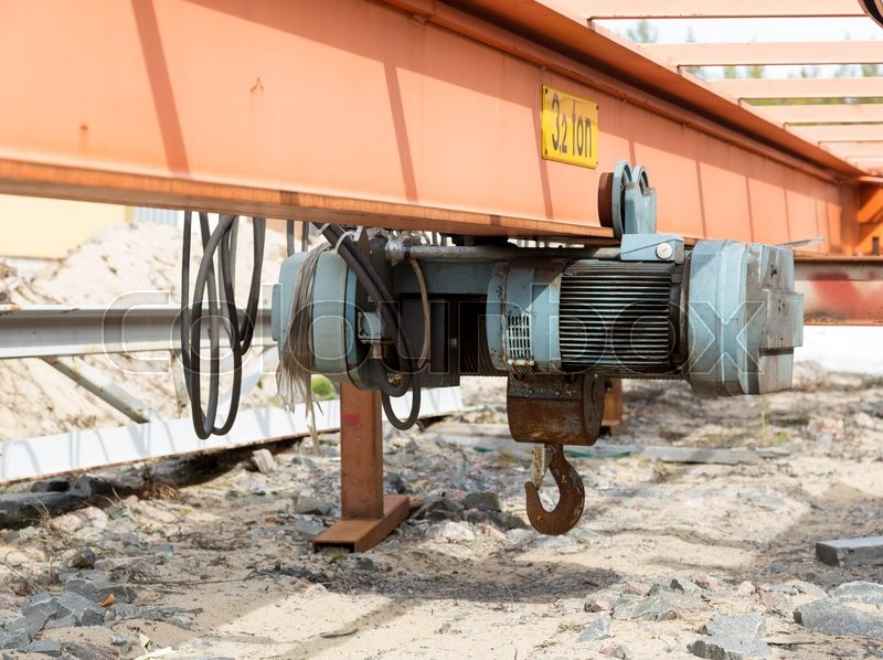 Stock image of 'A small electrical lift on a girder of steel'