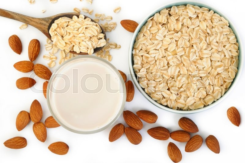 Stock image of 'almond milk in glass with oats'