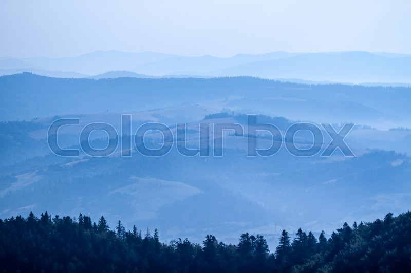 Stock image of 'blue foggy mountain landscape can be used as background'