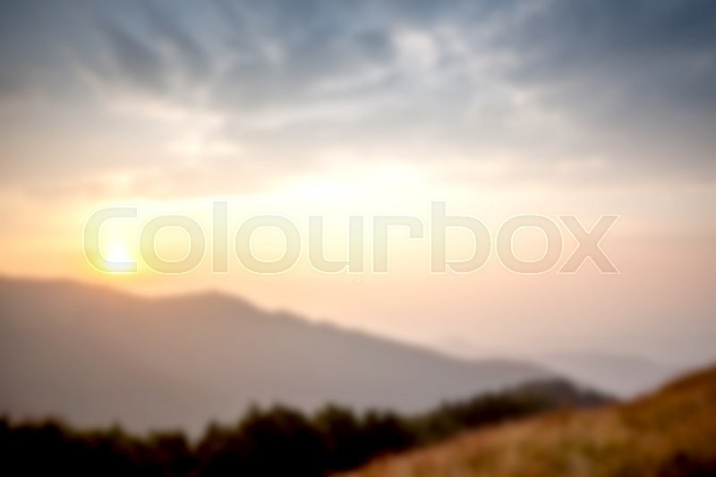 Stock image of 'foggy mountain sunset can be used as background'