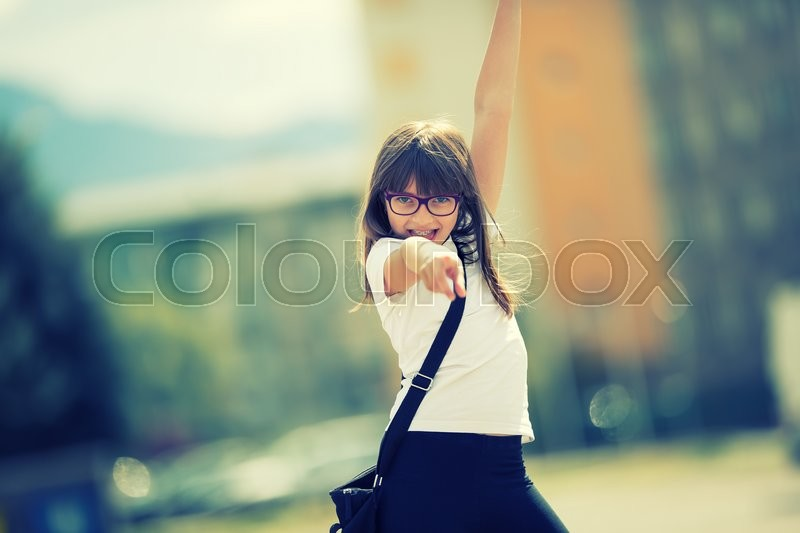 Stock image of 'Happy pre-teen young girl. Cute little girl in the city on a sunny day. Portrait young girl. Toned image.'
