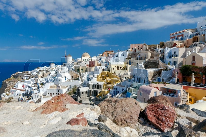 Stock image of 'View of the Oia, a beautiful village on the volcanic island of Santorini in the Mediterranean Sea.'