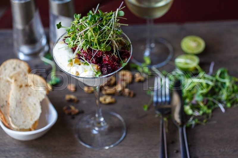 Stock image of 'Beet salad in a cocktail glass in a reastaurant '