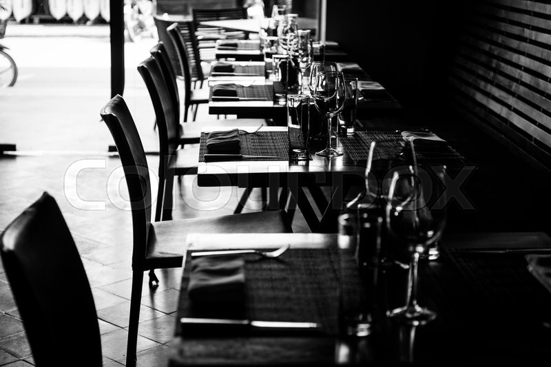 Stock image of 'Table setting in restaurant with wine and water glasses'