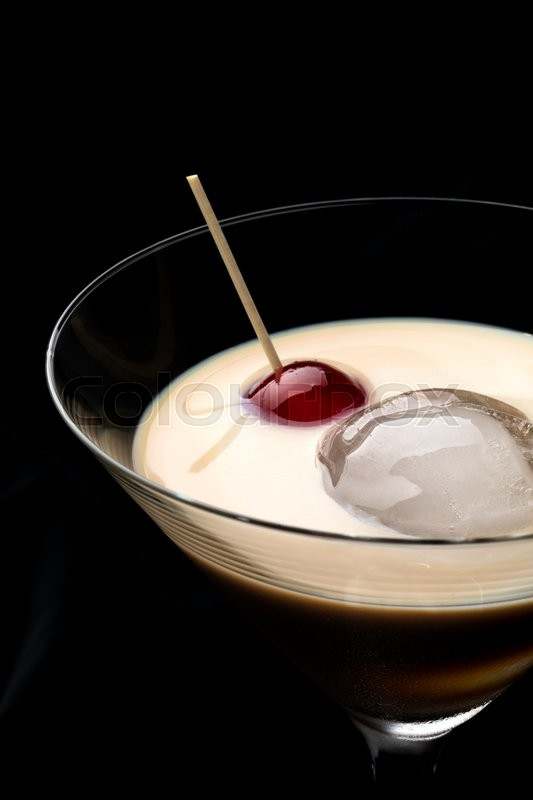 Stock image of 'Irish cream whiskey with ice and a sweet cherry'