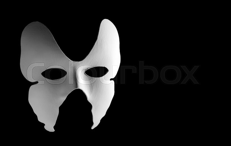 Stock image of 'White Italian mask carnival on black background with free space for text.'