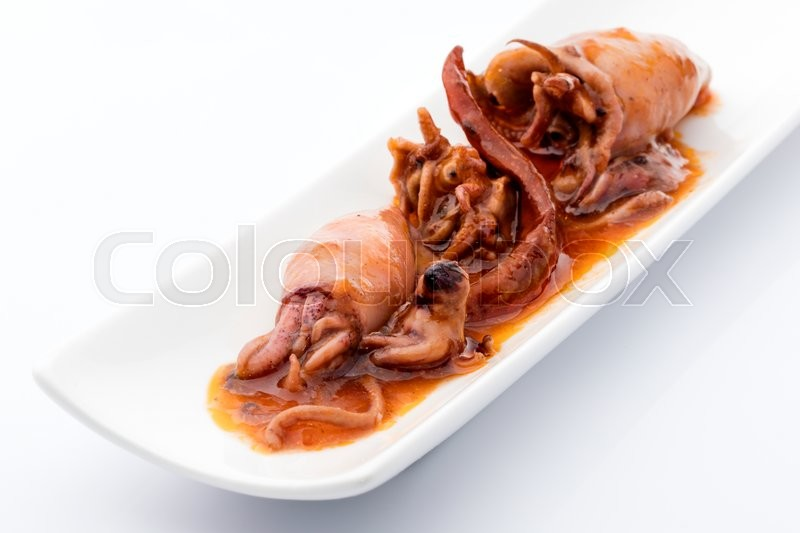 Stock image of 'snack squids conserve in hot pepper sauce on a white background'