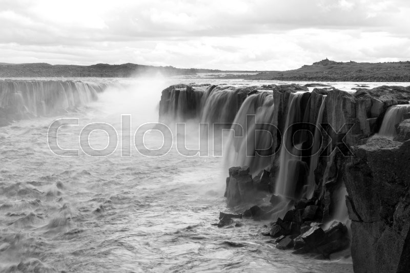 Stock image of 'Northern gods. Iceland waterfalls in black and white, dramatic scene with a metaphoric look'