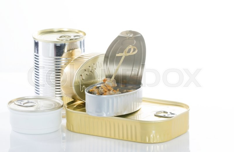 Stock image of 'Different kinds of food cans used for conserving food, and one of them, with cockles opened'