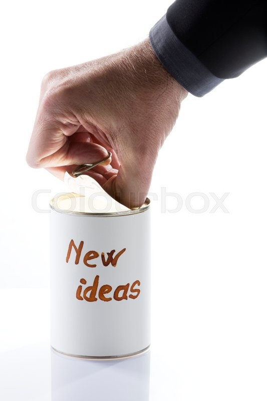 Stock image of 'Businessman opening can full of new ideas, figurative photo with a bright light into the can'