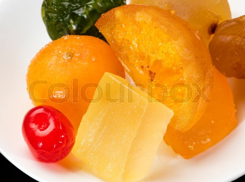 Stock image of 'colorful fruit glazed, cherry, pumpkin, plum and orange'