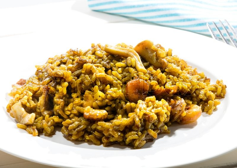 "Stock image of 'typical Spanish rice recipe called ""Paella"" due to the recipient in where it is cooked. In this case the recipe has seafoods'"