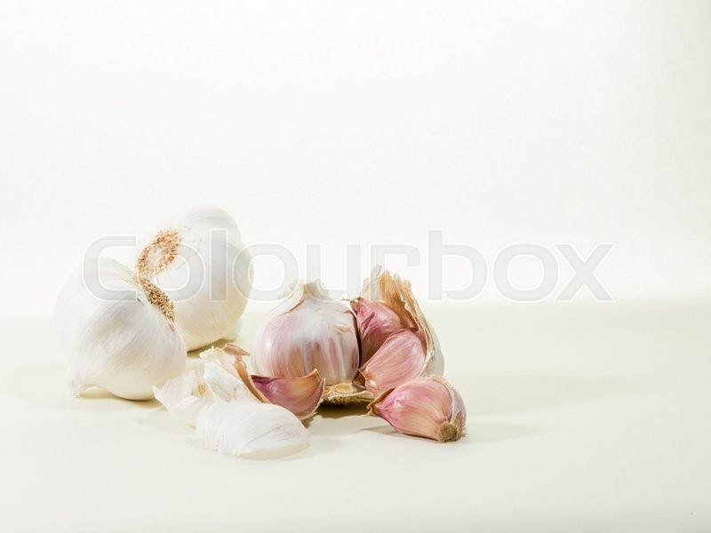 Stock image of 'white garlics, one of them opened'
