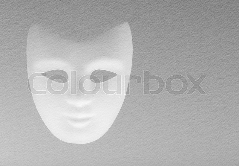 Stock image of 'white mask texturized on a white paper'
