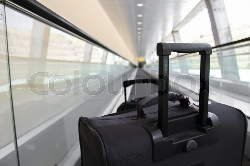 Stock image of 'two suitcases on the treadmill departing or arriving'