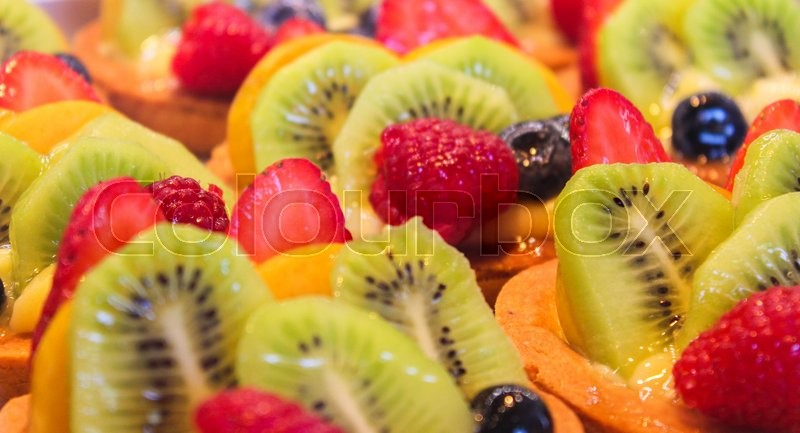 Stock image of 'fruit salad with kiwi, strawberries and other summer fruits'