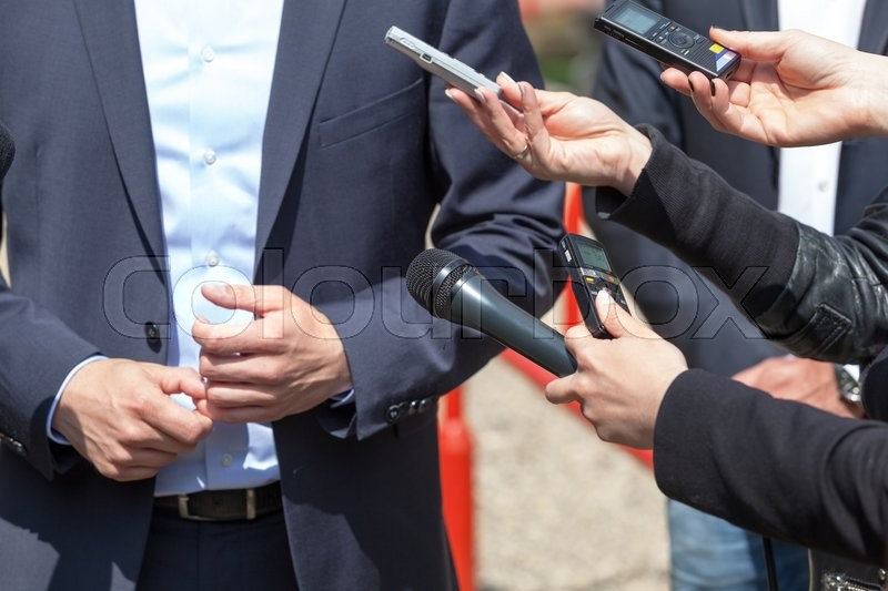 Stock image of 'Journalists making interview with businessman or politician'