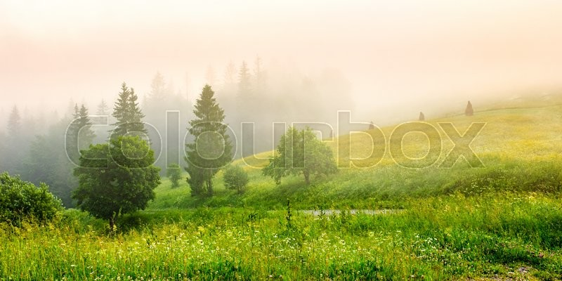 Stock image of 'cold morning fog with red hot sunrise in the mountains'