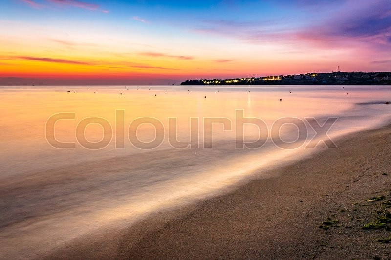 Stock image of 'urban sand beach in the early morning calm. resort town wakes up after rough night.'