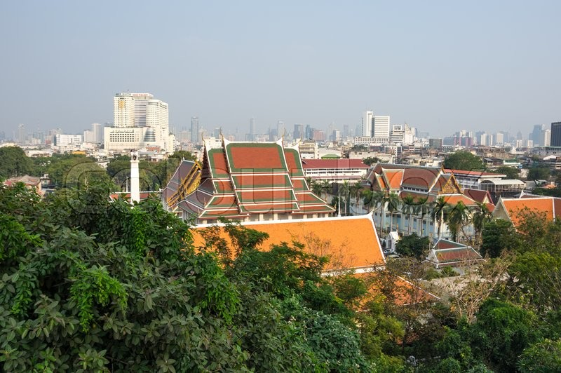 Stock image of 'BANGKOK, THAILAND - JANUARY 25, 2015: Panorama view of buildings of Bangkok and part of Wat Saket from top of Golden Mount in Bangkok, Thailand'