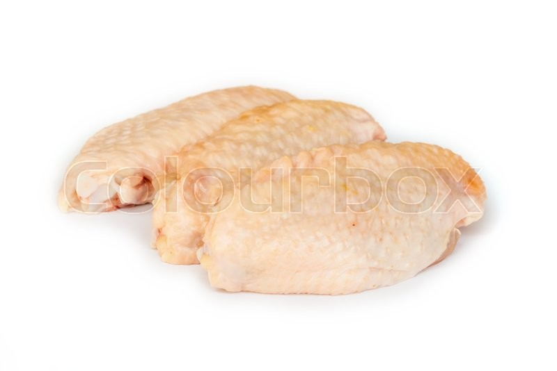 Stock image of 'Pieces of raw chicken meat on white background.'